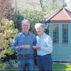 Roy Dorland is presented with his National Garden Scheme award by Patricia Elkington