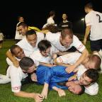 Totton players celebrate with then manager Stuart Richie during their FAC Up run
