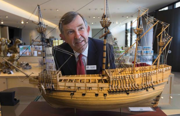 Daily Echo: John Lippiett, chief executive of The Mary Rose Trust with a model of the ship.