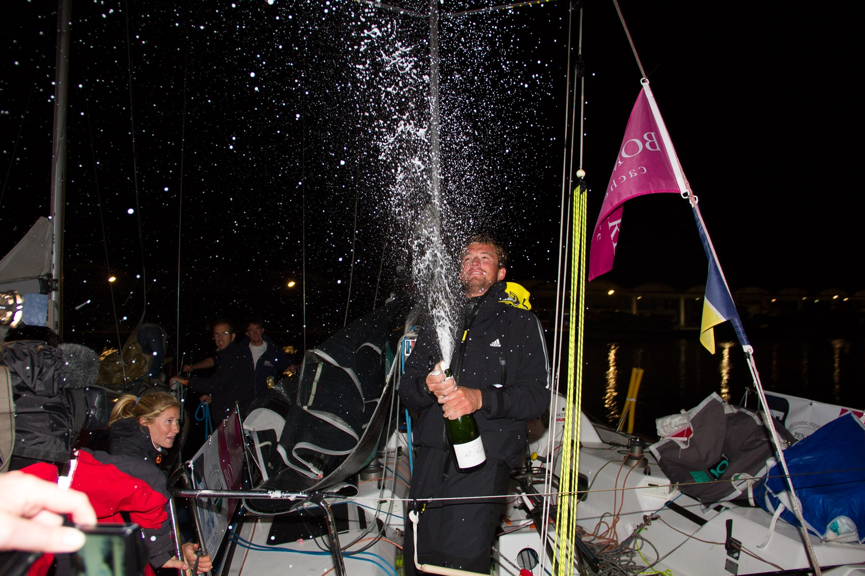Sam Goodchild celebrates completing the Solitaire du Figaro