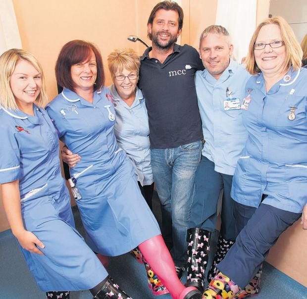 FUNKY: Mark Caine with nurses Joanne Holden, Sandie Millan, Annie Gale, Stephen Mould and Sandra Chapman