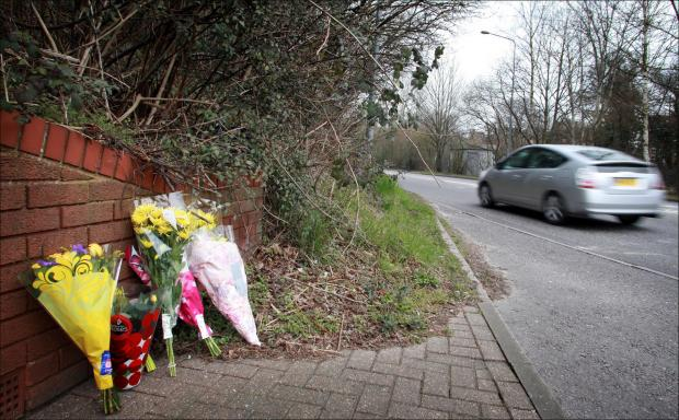 Daily Echo: Flowers left at the scene of the fatal crash on Thomas Lewis Way in which PC Steve Rawson was killed