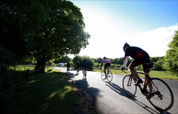 Cyclists taking part in a Wiggle cycling event in the New Forest