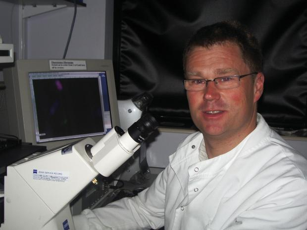 Dr Jeremy Blaydes at the microscope