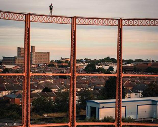 Daily Echo: James Kingston stands atop one of the gasometers in Northam, Southampton