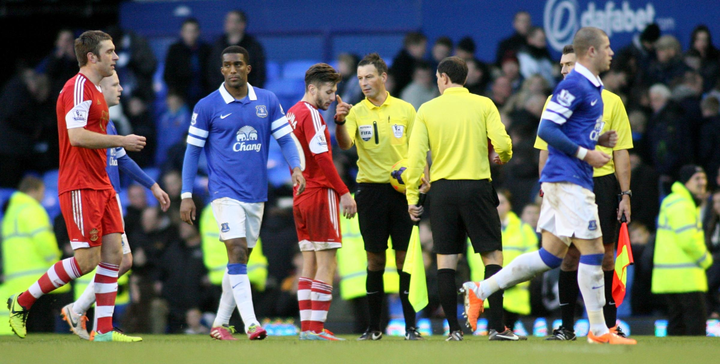 Mark Clattenburg speaks to Adam Lallana at the end of the game at Goodison Park