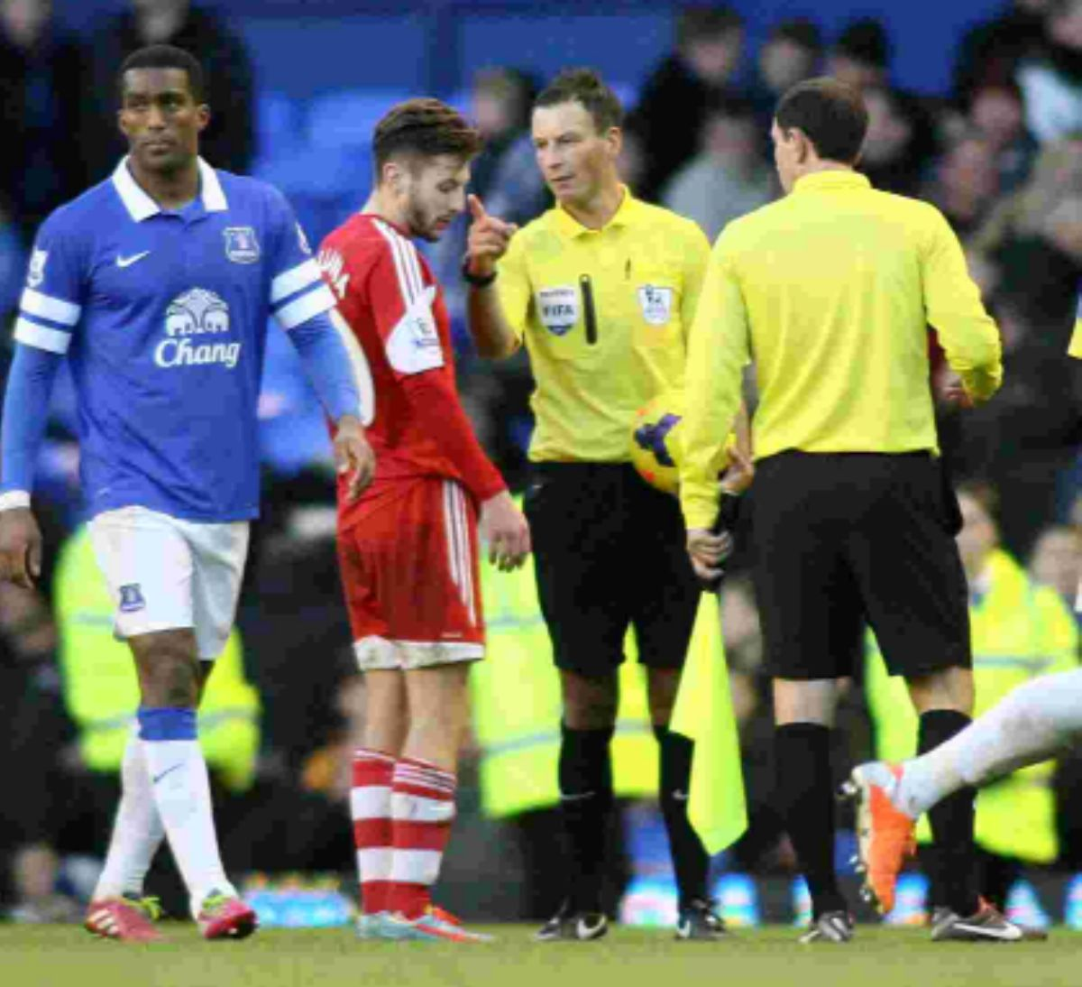 Mark Clattenburg speaks to Adam Lallana during Saints' 2-1 defeat at Everton