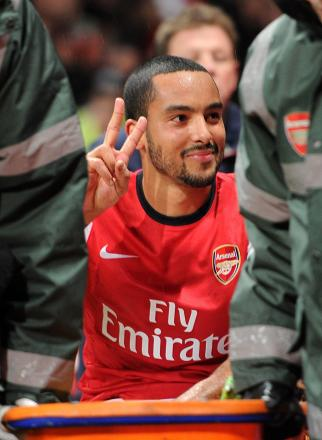 Police hunt after ex-Saints star Theo Walcott is pelted with coins