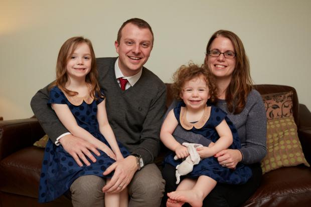 Microbiologist Zoe Gunning with her husband Matt and daughters Evelynne and Isla..