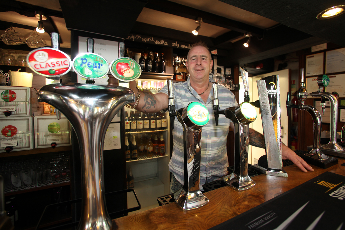 CLOSED: Landlord Duncan Owers behind the bar at The White Horse.