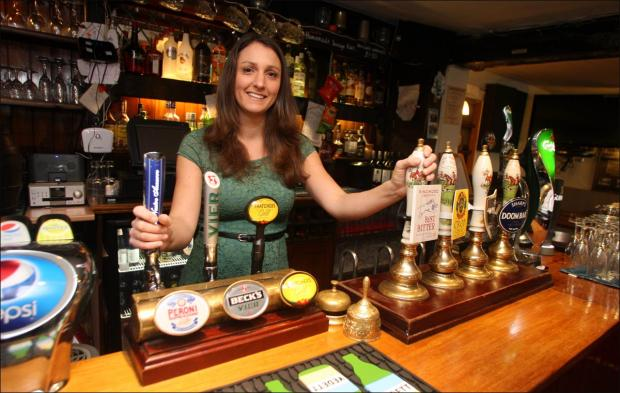 Michelle Francis behind the bar at the King's Head.
