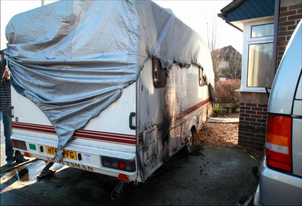The caravan that was set on fire in Woodlands Way.