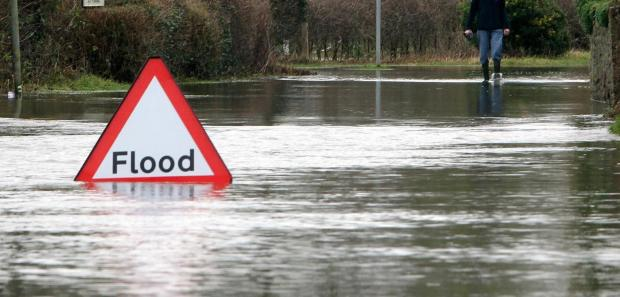Woman driver rescued from flood water