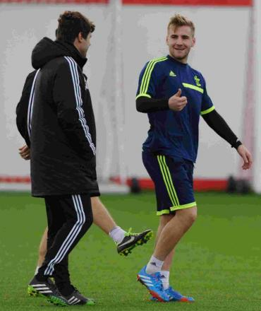 Luke Shaw talks to Mauricio Pochettino at training today just hours after Nicola Cortese's resignation.