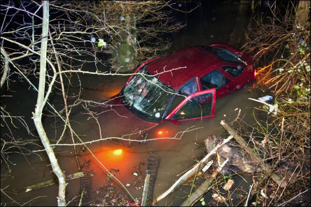 Incredible escape of driver whose car ended under water in dramatic crash