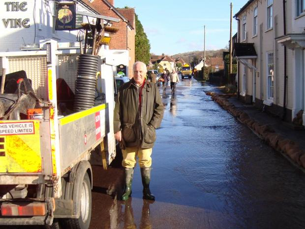 Council leader Roy Perry during the clean up at Hambledon