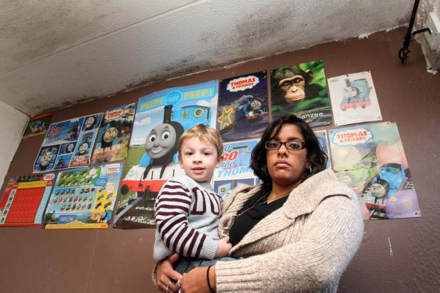 MOULD HORROR: Samantha Simpson with son Zachary in the three-year-old's bedroom.