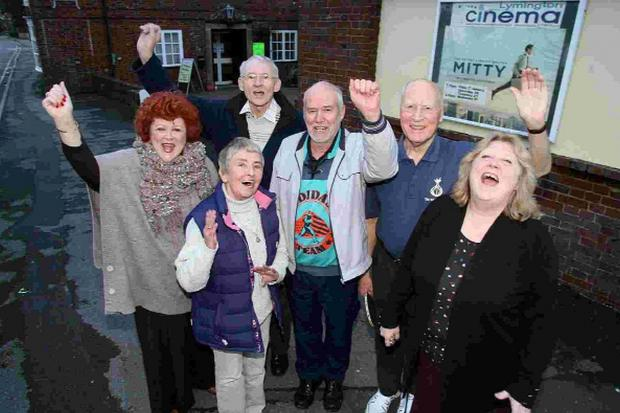 Manager Penny Bicknell, right, cinema-goers and staff celebrate the saving of the town's only cinema