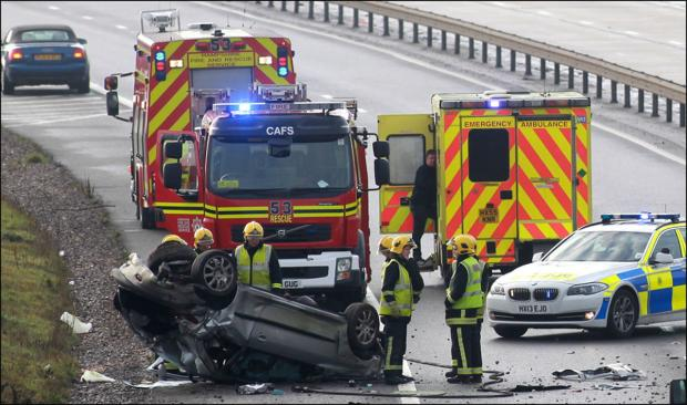 Police close motorway after car overturns