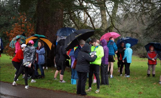 Runners prepare in heavy rain for Romsey 5 mile race this morning.