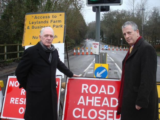 Mike Thornton MP, right, visits the roadworks with Cllr Des Scott.