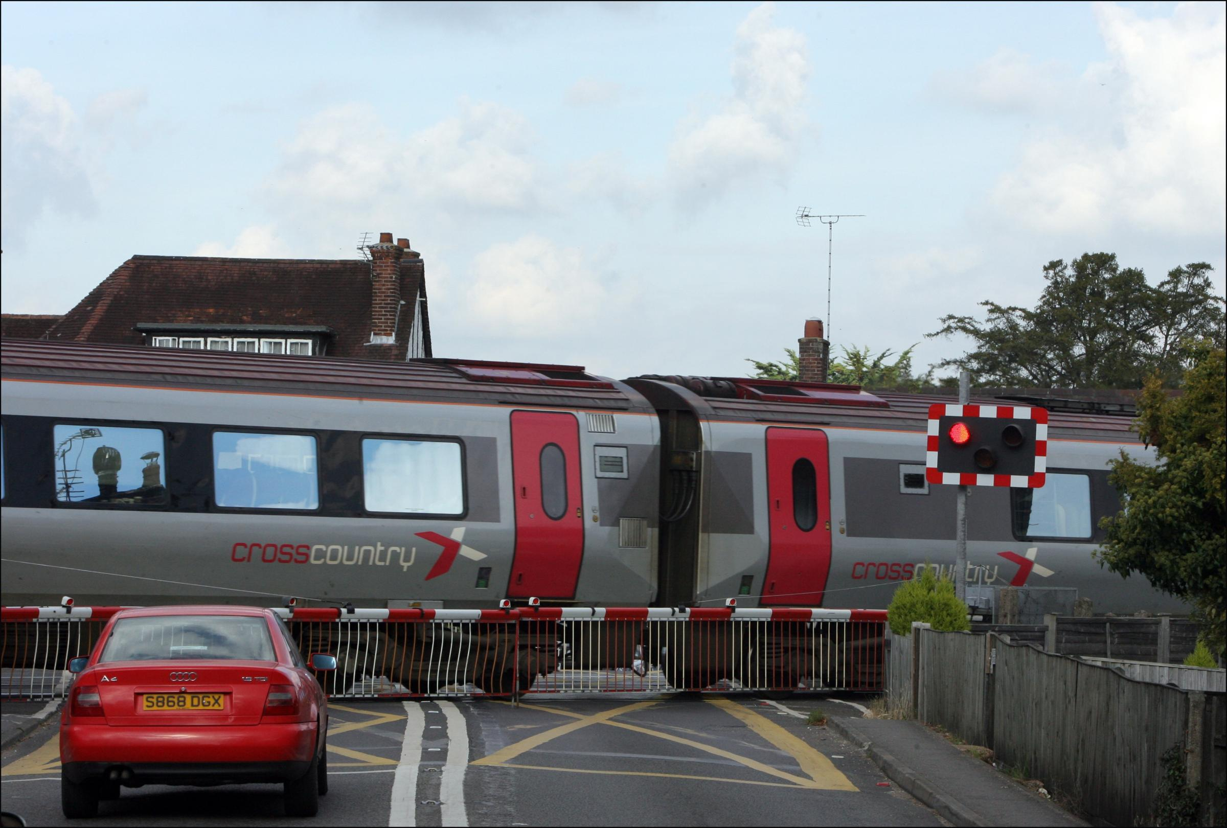 Road shut after level crossing breaks down