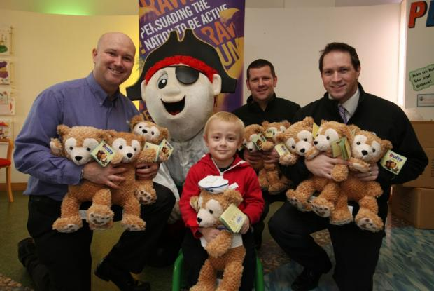From left are Ross McClean, Jon Randall and Mark Learnihan with Captain Quays and patient Cameron Holder, 4.