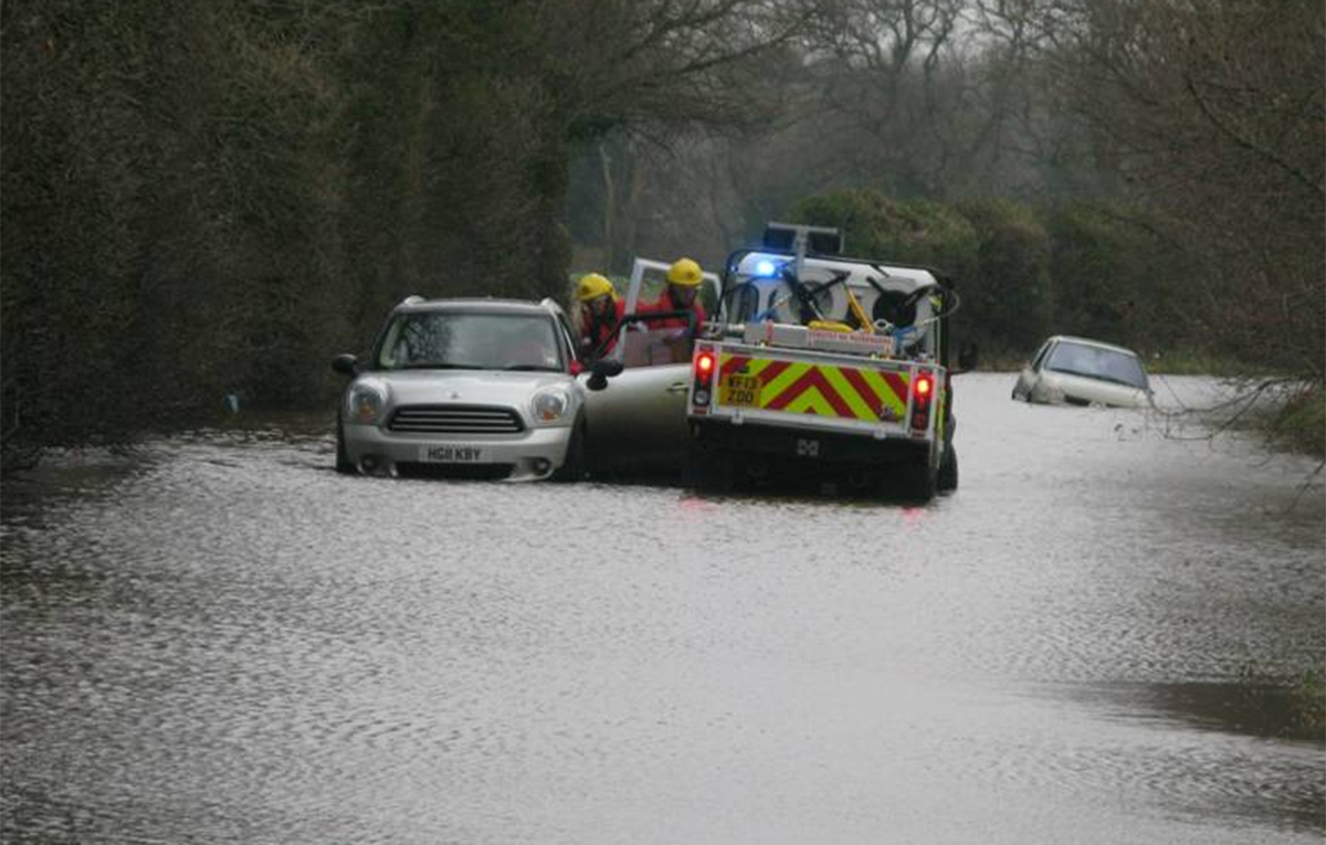 Pensioner rescued from Mini on flooded road