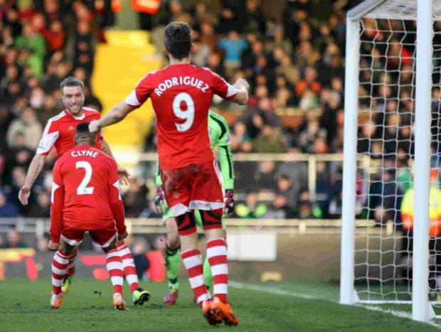 Rickie Lambert celebrates netting his 100th league goal for Saints.
