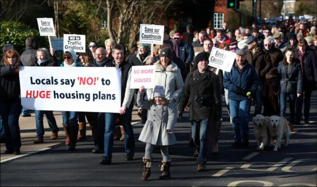 Campaigners protesting against the housing plans.