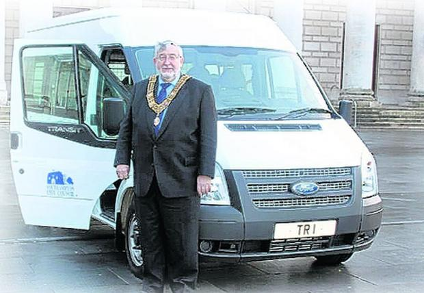 Mayor Ivan White with the new minibus which now bears the number plate