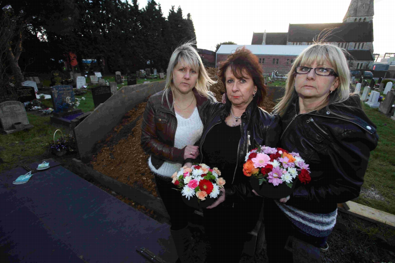 Family fury as dirt is dumped on grave