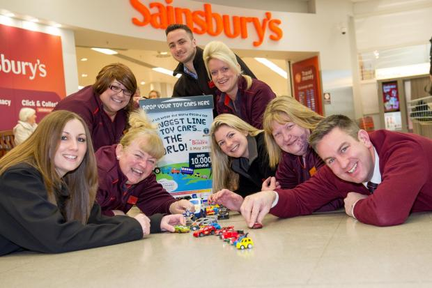 Sainsbury's help the National Motor Museum to collect toy cars, pictured are staff members Lesley Powell, Sarah Davies, Sarah Wright, Kim Johnson, Phil Bridgwater, Andy Ollerenshaw, Caroline Sparks and Linda Langdon.