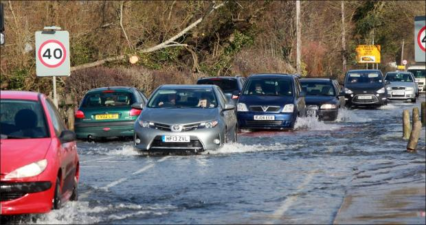 Football fans urged to avoid flooded routes
