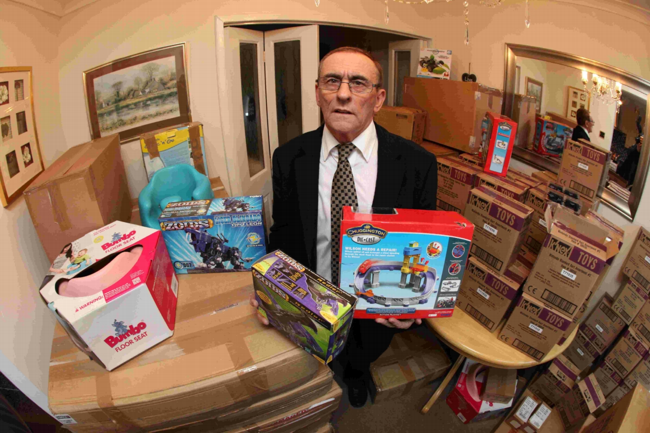 Totton councillor Neville Penman with boxes of toys that will be donated to children at Southampton General Hospital.