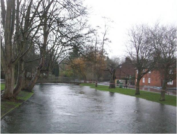 Flooding in Water Lane, Winchester, where the military are building a sandbag wall to prevent the River Itchen flowing into homes