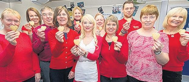 Staff from Babcock, at HMS Collingwood, show support for BHF's Ramp Up the Red campaign