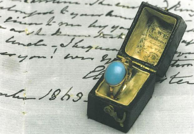 The turquoise and gold ring.