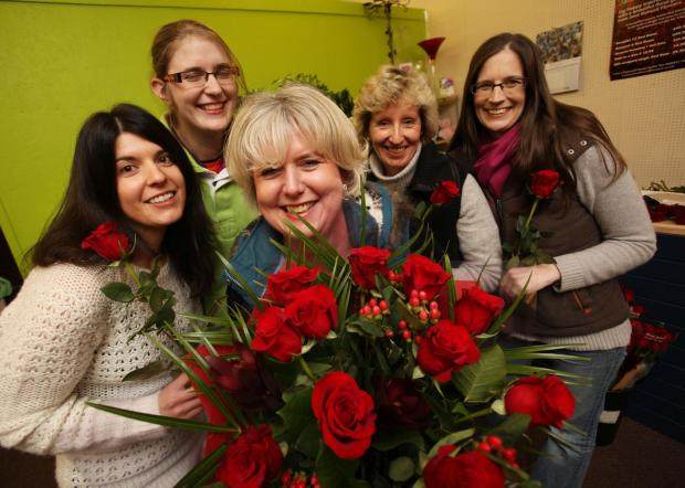 Daily Echo: Jane Bidwell, centre and florists, from left, Miriam Nicholson, Steph Neale, Jane Randell and Janette Whiteway.