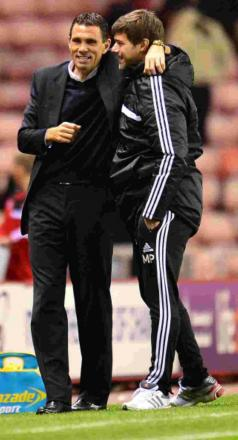 Gus Poyet, left, with Saints boss Mauricio Pochettino earlier this season.his