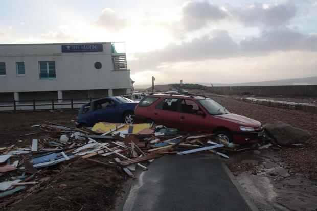Diners rescue as from restaurant battered by stones from beach blown by 80 mile and hour winds