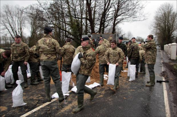 Hundred of troops in race to save 300 homes from flooding in Hampshire