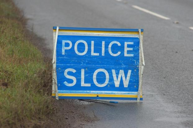 Road blocked as motorist freed from overturned car