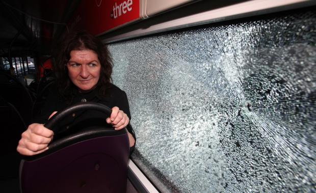 Alison Henderson from First Bus inspects the damage after the attack
