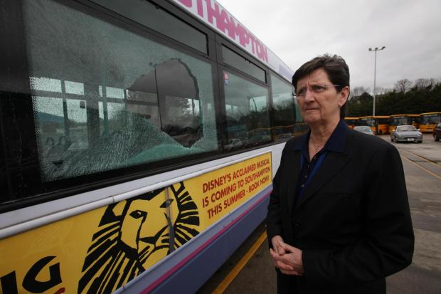Chrissie Bainbridge from First Bus inspects the damage after vandals attacked