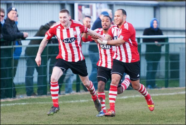 Lee Wort celebrates the winning goal with team mates.