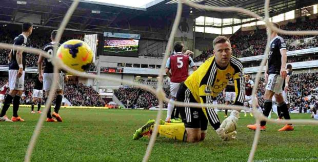 Saints 'keeper Artur Boruc looks dejected after West Ham's Carlton Cole scores his side's second goal.