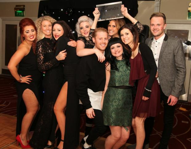 The Strands hairdressing team celebrate