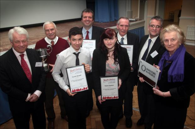 Chairman of the Youth Options trustees Mike Gretton with award winners Darryl Saxton, Curtis Newell, Ian Stickland, Kylie Hawton, Paul Sillence, Mark Dixon and Lord Lieutenant Mary Fagan.