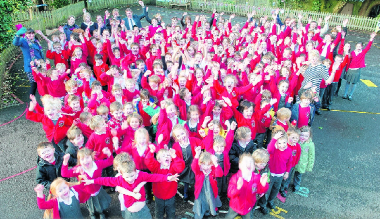 Pupils and staff at Brockenhurst Primary School celebrate their Ofsted report.